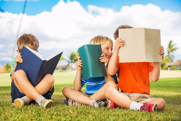 Happy Kids Reading Books Outside small