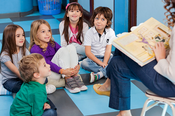 Teacher reading to kids small