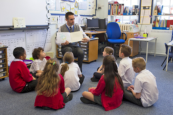 Teacher reading to students small