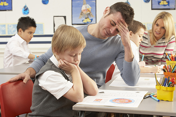 boy and frustrated teacher small