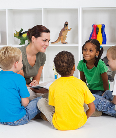 Teacher reading to kids cropped