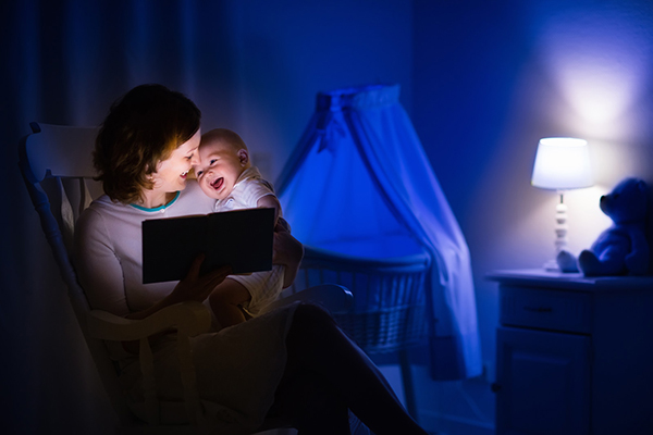 Mother reading to baby 2 small